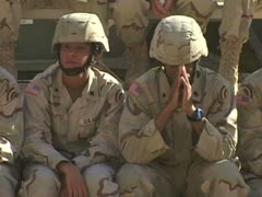 Soldiers sitting during service outside Stock Footage