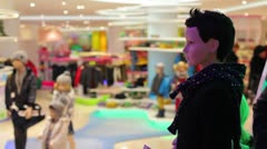 Shoppers in the store of fashionable children's clothes Stock Footage