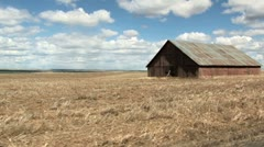Old barn drive by Stock Footage