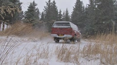 Red Pickup Drives Around Corner in Snowstorm Blizzard Stock Footage