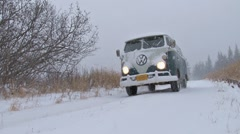 Classic VW Bus Van Drive By in Blizzard Stock Footage