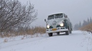 Stock Video Footage of Classic VW Bus Van Drive By in Blizzard