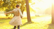 Young happy woman spinning  in beautiful autumn park, slow motion Stock Footage
