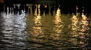 Stock Video Footage of MVI 9150 City Lights Reflect in Hudson with Pier Pilings