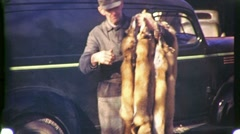Trapper Displays Fox Skins Pelts Circa 1940 (Vintage Home Movie Footage) 1188 Stock Footage