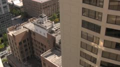 City Skyscraper buildings looking down on alleys Stock Footage