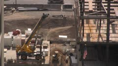 Stock Video Footage of Construction site crane building on a city skyscraper