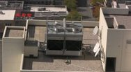 Stock Video Footage of Industrial fans spinning on the roof of a building