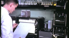 SCIENTIST Reads LABORATORY Data Print-out 1960s Vintage Retro Film Movie 1203 Stock Footage