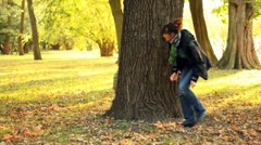 Young mother with her son playing in autumn park Stock Footage