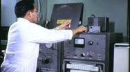 Stock Video Footage of SCIENTIST MEASURES RADIOACTIVITY 1965 (Vintage Industrial Film Footage) 1204