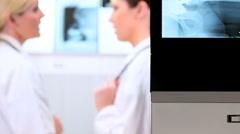 Female Doctors Examining Radiology X-Rays - stock footage