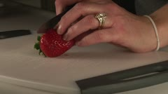 Cutting up fresh Strawberries cooking preparing food working kitchen Stock Footage