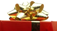 Ribbon on christmas present looping Stock Footage