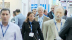 Business people walking at trade show Stock Footage