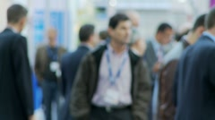 business people walking at trade show - stock footage