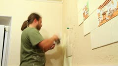 master applies decorative plaster on the wall. Timelapse. - stock footage