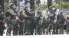 Pan Riot Police Heavily Deployed - Neo-Nazi Rally NSM - Pomona, CA - Nov 5, 2011 - stock footage