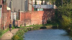 Cyclist on Canal Tow Path Stock Footage
