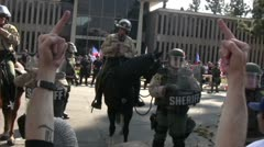 Flipping off Nazis and Police - Neo-Nazi Rally NSM - Pomona, CA - Nov 5, 2011 - stock footage
