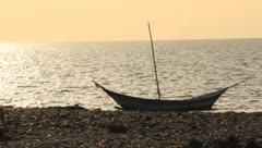 Small boat anchored on the coastline - stock footage