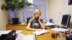 Secretary of deputy talking by phone in office Stock Footage