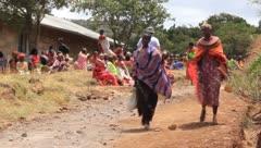 African women walking down dirt road - stock footage