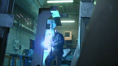Manual worker welding in industrial area Stock Footage