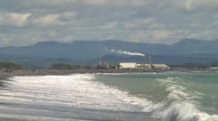 Industrial plant and the sea - stock footage