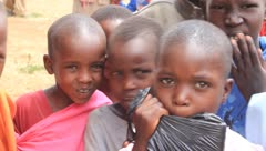 Group of young African children looking into the camera the camera Stock Footage