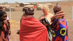 Blonde lady talking to small group of African people - stock footage