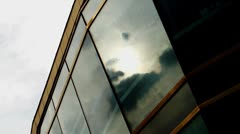 Timelapse of sun and dark clouds reflected on windows - stock footage