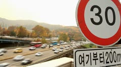 Timelapse of city traffic over 30 speed limit sign Stock Footage