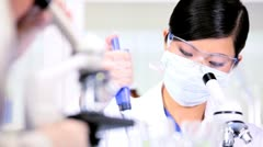 Young Female Using Medical Laboratory Equipment - stock footage