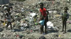 Poor children at trash dump Stock Footage