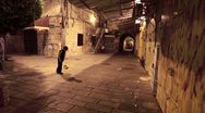 A boy playing soccer at night in Israel. Stock Footage