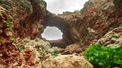 A naturally formed rock arch at Adamit Park Cave in Israel. Stock Footage