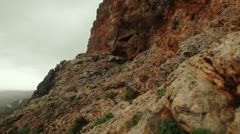 A cave in a rocky mountainside in Israel. Stock Footage