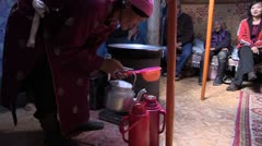 Mongolia: Filling Thermoses with Milk Stock Footage