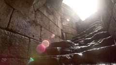 water trickling down ancient stone steps in Israel. - stock footage