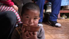 Mongolia: Sipping Milk from a Bowl - stock footage