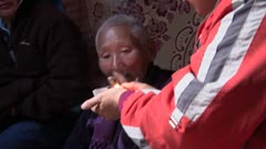 Mongolia: Smoking Grandma Stock Footage