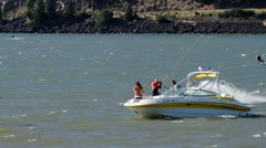 MVI 0541-orange rider jumps over boat Stock Footage