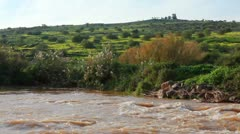The River Jordan with its silty water in Israel. Stock Footage