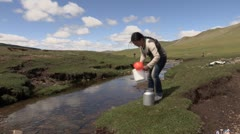 Mongolia: Girl Collects Water from Stream Stock Footage