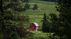 MVI 0666-Red barn in small vally Stock Footage