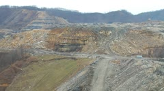 Pan of surface mining site and equipment Stock Footage