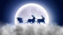 Santa with reindeer flies over night Stock Footage