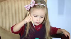 Girl learns to paint with a brush Stock Footage