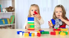 Two little sisters playing with the constructor. DOLLY HD Stock Footage